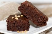 stock photo of brownie  - dark soft brownies on white plate close up - JPG