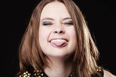 picture of sticking out tongue  - Young people teenage concept  - JPG