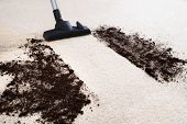 pic of carpet  - Photo Of Vacuum Cleaner Cleaning Dirt On Carpet - JPG