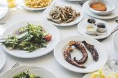 picture of greeks  - Table in greek restaurant - JPG