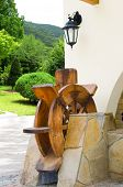 pic of water-mill  - Wooden water mill as a decoration of the house - JPG