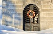 picture of mausoleum  - Mausoleum with a Christmas wreath on the door sits silently in the deep snows of Winter in Buffalo - JPG