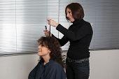 Постер, плакат: Woman at hairdresser beauty salon