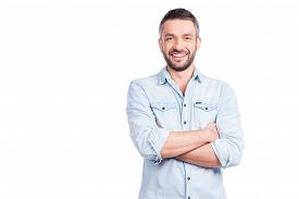 pic of denim wear  - Handsome young man in casual wear keeping arms crossed and smiling while standing isolated on white background - JPG