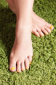 stock photo of painted toes  - Closeup of trendy colorful gel polished finger toes - JPG