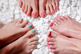 foto of painted toes  - Closeup of trendy colorful nail polished toes - JPG