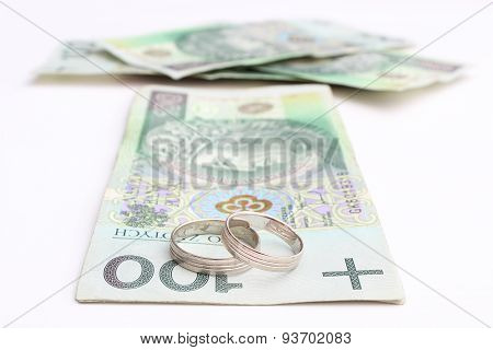 Wedding Rings And Money On A White Background