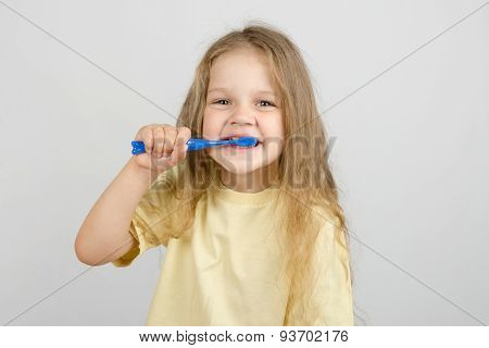 Four-year Girl Brushing Her Teeth