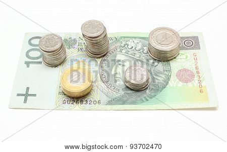 Banknote And Coins On White Background