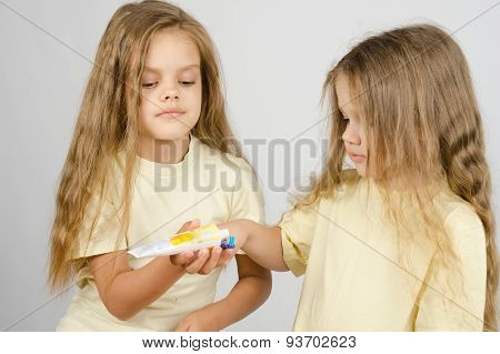 Girl Squeezing Toothpaste From A Tube Sister