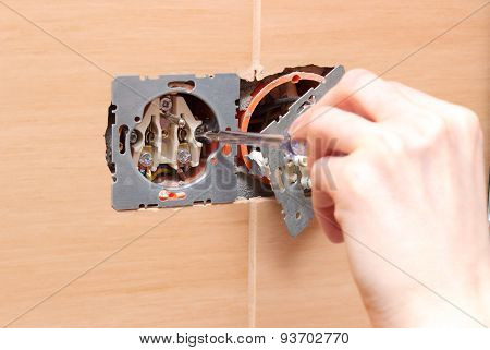 Electrician Installing A Power Socket