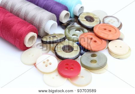 Colored Buttons With Colorful Spools Of Thread