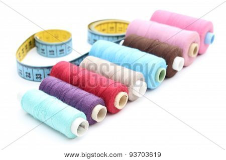 Colorful Spools Of Thread Tape Measure On White Background
