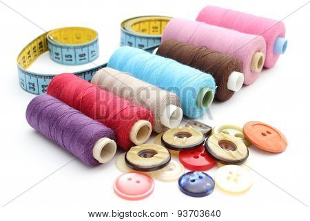 Colorful Spools Of Thread, Tape Measure And Colored Buttons