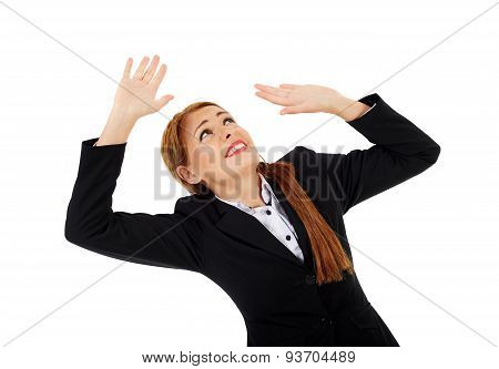 Businesswoman Getting Crushed By An Invisible Object