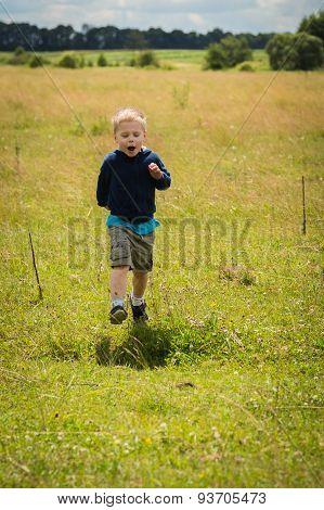 Little boy in a field of tall grass