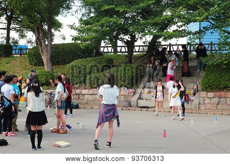 Japanese teenagers playing outdoor game activities