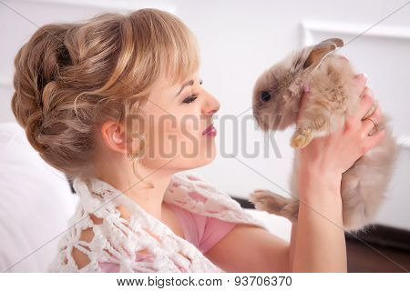 Young Woman With A Rabbit In Hands