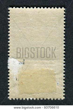 The reverse side of a postage stamp.