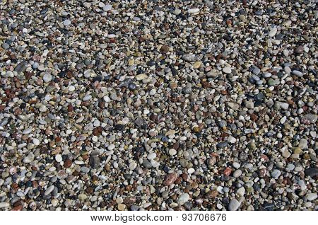 Wet Pebbly Beach Stone Background In Mediterranean Sea Beach