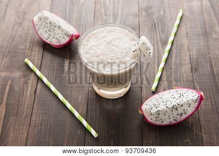 Dragon Fruit Smoothie And Drinking Straw On Wooden Background.
