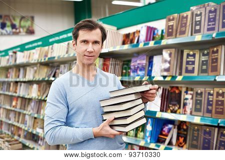 Man Chooses Book In Store