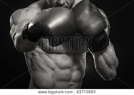 A man with a tattoo in red boxing gloves