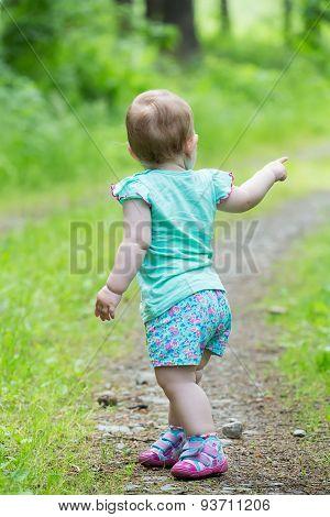 Cute Little Girl Walking Away On The Road Ahead