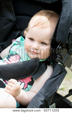 Cute White Blond Baby Girl On Stroller