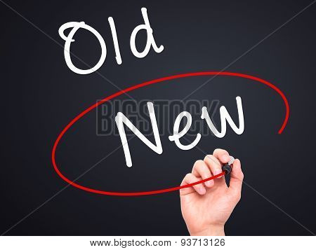 Man Hand writing and choosing New instead of Old with black marker on visual screen.