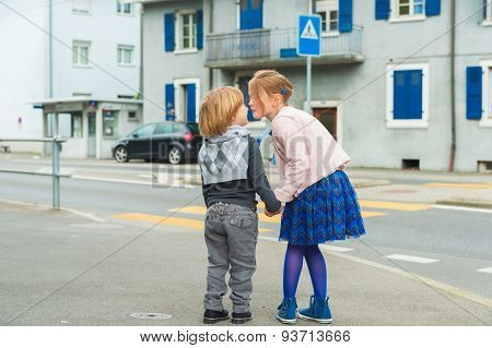 Portrait of two adorable kids playing outdoors