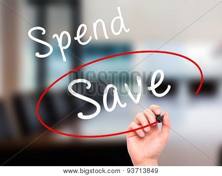 Man Hand writing and choosing Save instead of Spend with black marker on visual screen.