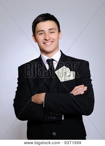Expressions - Young Handsome Business Man In Black Suit And Tie Counting Money. Gray Background
