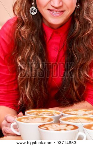 Beautiful girl with long hair in a cafe
