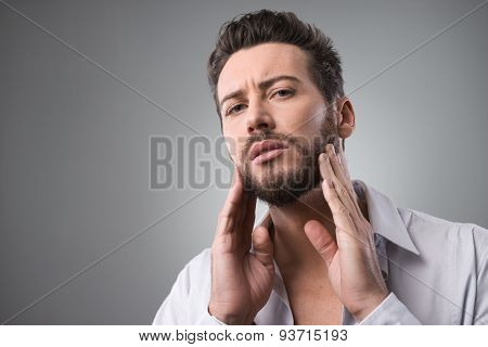 Man Checking His Beard