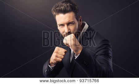 Angry Businessman Showing Fists