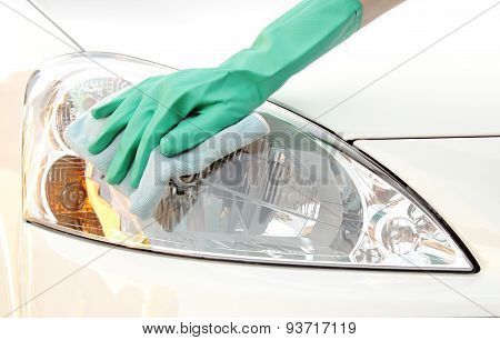 Woman Hand With Cloth Cleaning Car