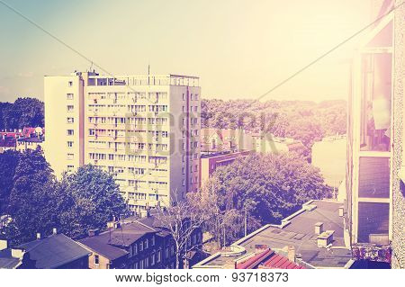 Retro Toned Picture Of Residential Block Apartments.