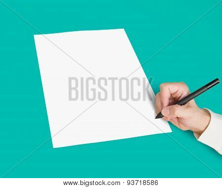 Hand With Pen Writing On Blank White Paper