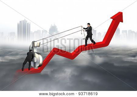 Two Business Men Moving Dollar Sign Upward Red Trend Line