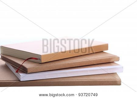 Pile Of Brown Notebook Isolated