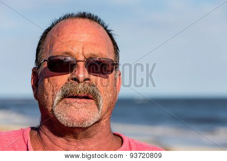 Old Guy On The Beach With Sunglasses