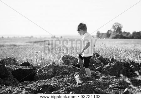 boy playing in the field