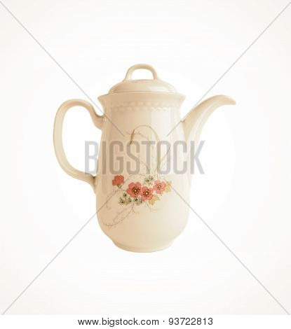 Porcelain teapot with floral patterns isolated in old style on white
