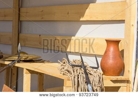 Gladiatorial Net And Trident On Wooden Bench