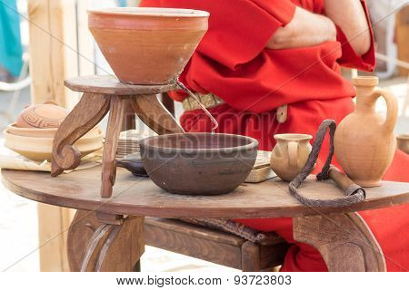 Ancient Roman Clay Moonshine And Utensils On Table