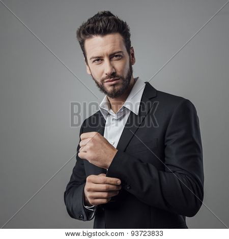 Elegant Young Man Adjusting His Jacket