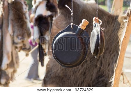 Leather Flask Hanging On Background Of Animal Skin