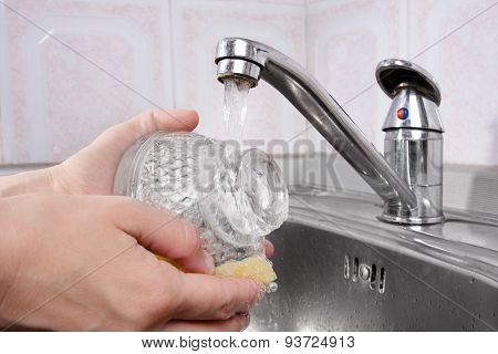 Hands Washing The Dishes