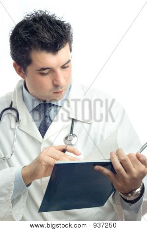 Young Physician Writing Down Notes In A Notebook